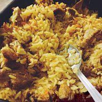 Фото к рецепту: Рис с мясом в духовке